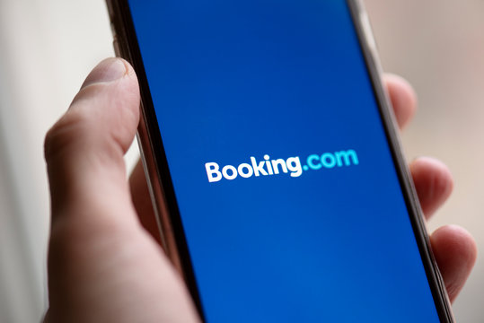 BERLIN - NOV 28: BOOKING.COM Logo on Screen of Mobilу Phone in Berlin On November 28. 2019 Germany. Booking.com is a travel fare aggregator website and travel metasearch engine for lodging reservation