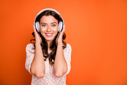 Portrait of positive cheerful girl listen music wear white head phone feel pleasure emotions wear stylish clothing isolated over shine color background