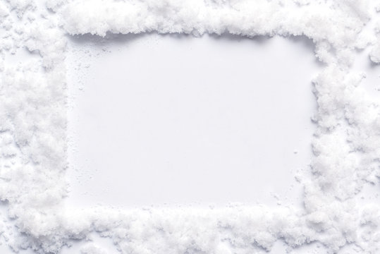 Christmas snow effect background for message board with snowflakes border and white winter style centre