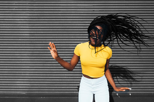 African american woman waving her dreadlocks