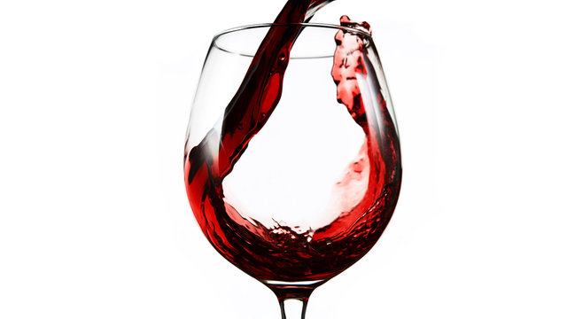 Detail of pouring red wine into glass on white