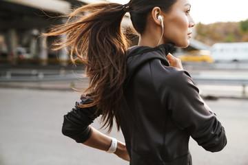 Fototapeta Strong fitness woman running outdoors by street. obraz