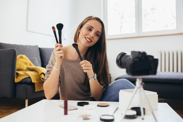 woman vlogging about makeup products