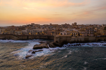 Aerial view of the bay, overlooking a sailboat and fort in the city of Syracuse. Island Sicily Italy.