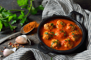 Spicy meatballs in tomato sauce, a typical Spanish and Mexican bar food, so called albondigas