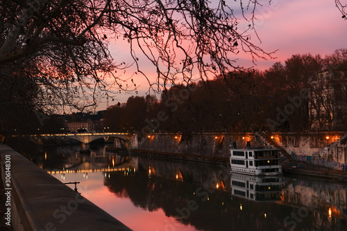Fotomurales Evening on the embankment by the Tiber River. Rome. Italy. City landscape.