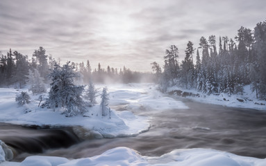 Stores photo Rivière de la forêt Ice fog and hoar frost on a 30 below winter morning at the waterfalls on the Wabigoon River, Northwest Ontario, Canada.