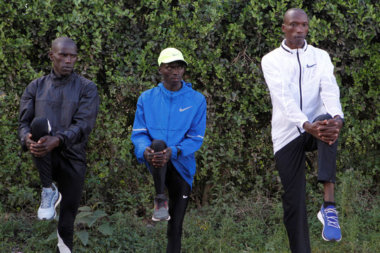 Timothy Cheruiyot winner of the 1500 meters gold medal at the 2019 World Athletics Championships in Doha, stretch before an evening run at the Rongai Athletics club in Kajiado county