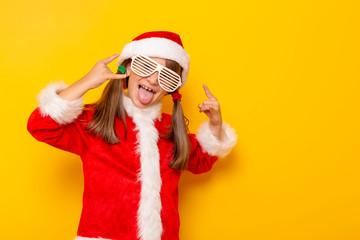 Child in Santa costume having fun