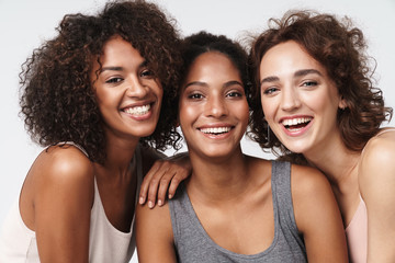 Portrait of young multiracial women standing together and smiling