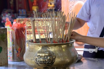 Smoke from many incense sticks that burning and embroidered in incense burner, Buddhists pray to be happy in the new year and ward off bad luck.