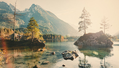 Photo in autumn. Sunlight in the Forest with Retro Instagram Style Filter. Famous lake Hintersee. Nationalpark Berchtesgadener Land, Upper Bavaria, Germany