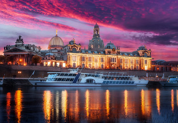Printed kitchen splashbacks Eggplant Impressive sunset on Elbe river Scenic sunset view of ancient buildings and street architecture in the Old Town with colorful clouds under sunlit. Famouse Dresden, Bavaria, Germany.