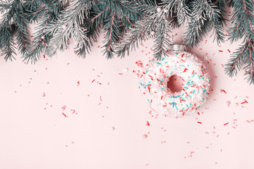 Wall Mural - Christmas creative background with Christmas bauble made of glazed donut and sugar sprinkling