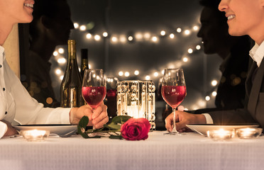 Wall Mural - Couple enjoying a romantic candle light dinner