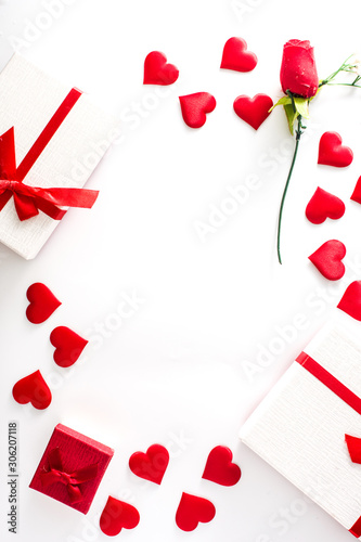 Valentine's Day background with heart, gift boxes and rose on white background. Copy space