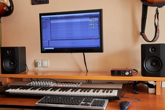 Audio Home Studio equipped with midi keyboard, monitors and sound card