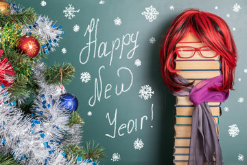 Happy New Year ! Funny educational idea with a red-haired teacher