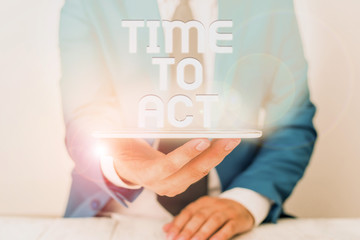 Text sign showing Time To Act. Business photo text Do it now Response Immediately Something need to be done Businessman in blue suite with a tie holds lap top in hands