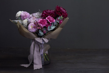 Pink and purple toned bouquet in vintage style on a dark background, selective focus Fotobehang
