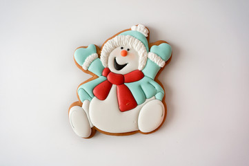 Gingerbread cookie snowman sugar glazed on white background