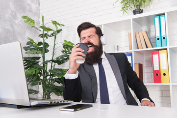 Singing businessman. Businessman sing song at workplace. Businessman hold coffee cup as microphone. Bearded businessman have fun during work break. Music. Entertainment. Relaxation