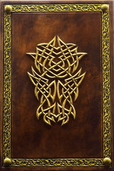 Leather book with the gilded frame and the symbol in the center of the cover captured isolated