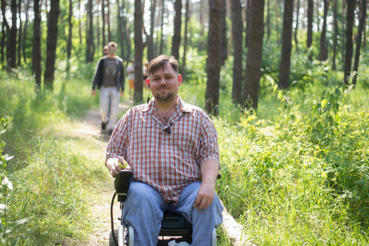 man in a wheelchair in a forest
