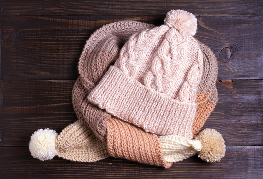 Handmade knitted woolen hat and scarf, cold season concept. Women winter warm accessories. Flat lay, high angle view