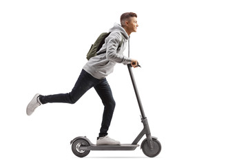 Male student with a backpack riding an electric scooter