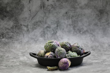 Canvas Prints Brussels A Bowl of Brussels Sprouts on grey background.
