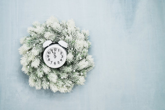Christmas background. White Christmas wreath on blue background. Copy space
