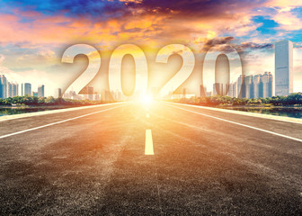 Spoed Foto op Canvas Nacht snelweg Straight ahead to the modern city with the New Year 2020 concept. The 2020 number written in modern cities.