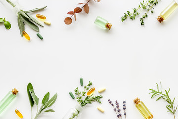 Apothecary of natural wellness and self-care. Herbs and medicine on white background top view frame copy space Fototapete