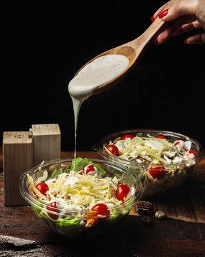 caesar salad seasoned with garlic sauce