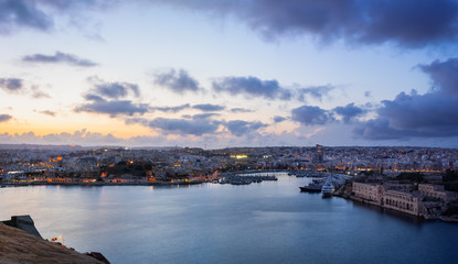 Malta. Panoramic view of Marsamxett Harbour from the city walls of Valletta in the evening.