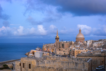 Malta. Skyline of Valletta at sunset with Basilica and St. Paul's Anglican Cathedral