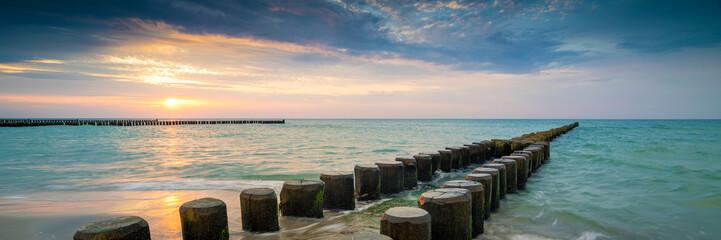 Fotorollo Blau türkis Sonnenuntergang am Ostsee Strand