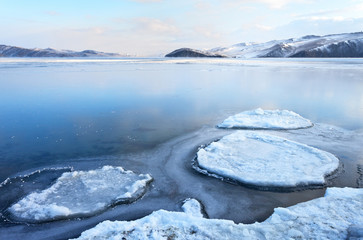 Baikal Lake in December morning. The formation of ice in the Olkhon Gate Strait. Beautiful winter landscape. Change of seasons, cold weather, calendar: November, December