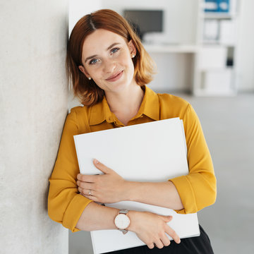 Friendly relaxed young woman in the office