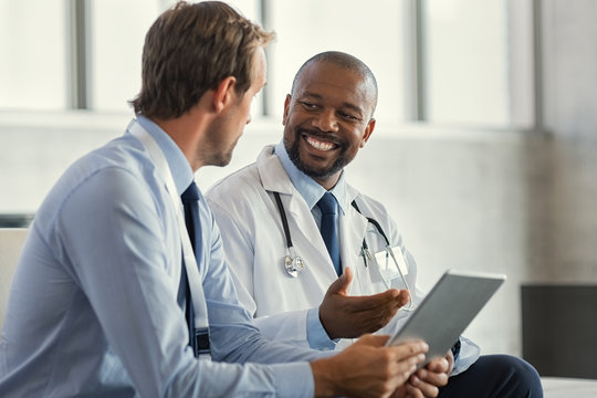 Multiethnic specialist doctors discussing case