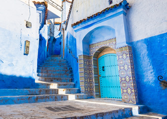 Deurstickers Traditional blue door in Chefchaouen city n Morocco with beautiful light