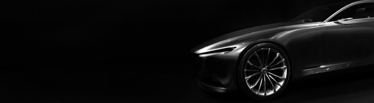 Silhouette of black sports car with one LED headlights on black background,copy space