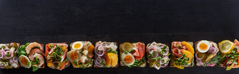 Photo on textile frame Snack panoramic shot of fresh danish smorrebrod sandwiches on grey surface