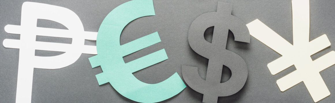 top view of peso, euro, dollar and yen sign on grey background, panoramic shot