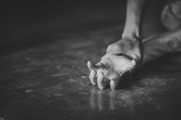 Man's hand holding a woman hand for rape and sexual abuse,   problem or Social issues concept. black and white picture.