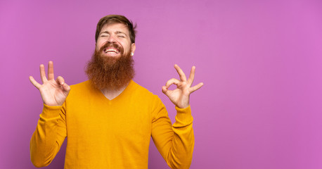 Foto op Canvas Zen Redhead man with long beard over isolated purple background in zen pose