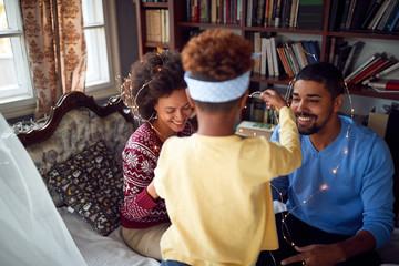 African American Family enjoying on winter holiday.happy family celebrate Christmas