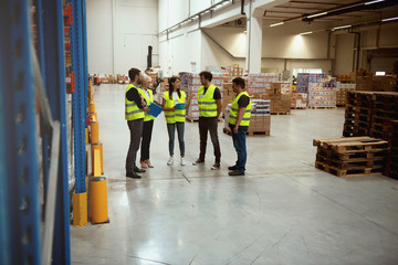 Warehouse meeting, managers and workers