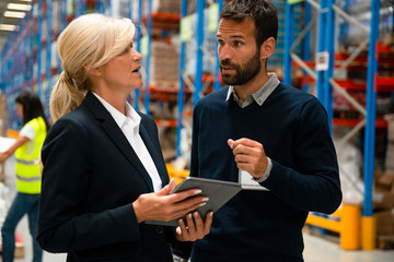 Managers in Warehouse discuss about business